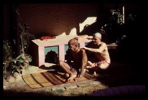 Srila Prabhupada being massaged in his back garden in Vrndavana November 1976